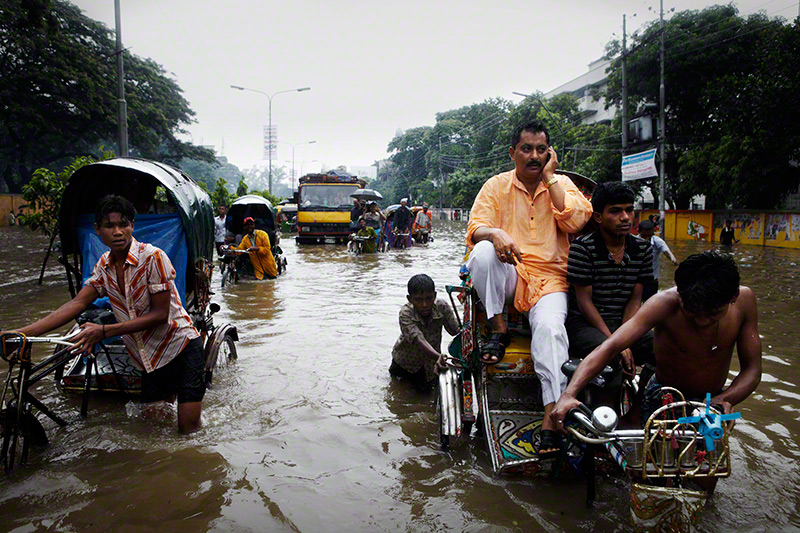 Arambagh, Dhaka, Bangladesh, 2009. After a night of heavy rain, Dhaka experienced widespread  flooding around the city. � Jonas Bendiksen.